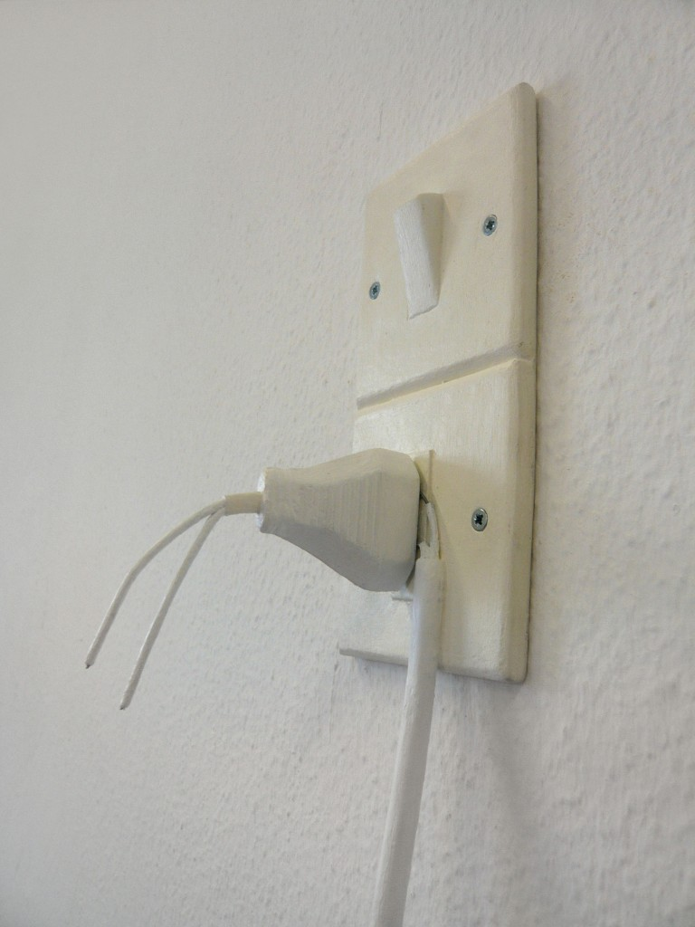 Plug 2013,Object painted cardboard.80x140x40cm low